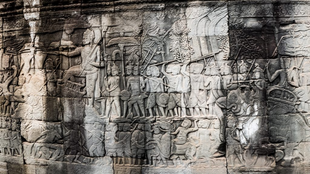 Carving depicting the clash of Korean and Japanese selfie-sticks going on right behind me. Carnage @ Bayon Temple, Angkor Thom, Cambodia