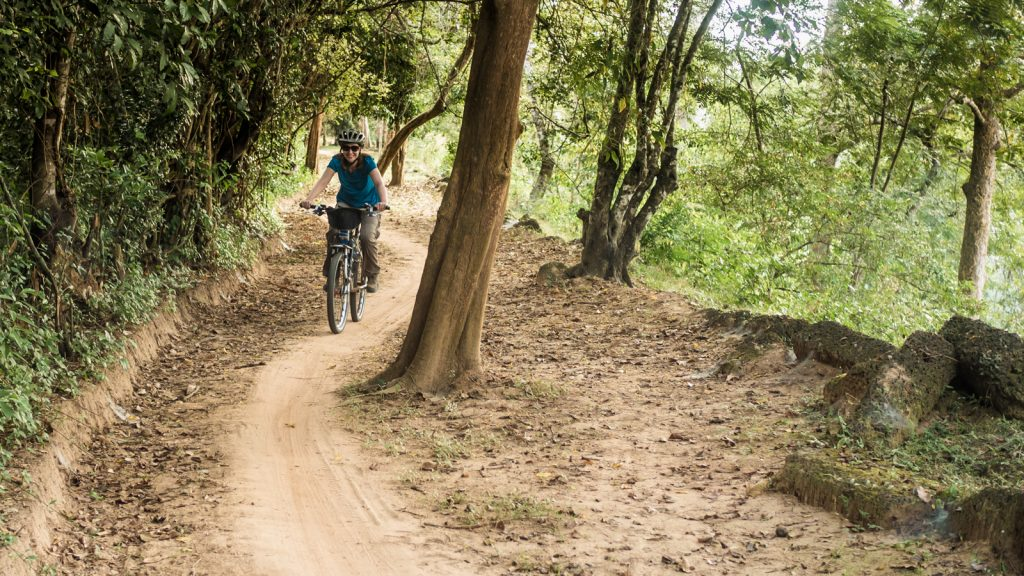Cycling the wall of Angkor Thom, Cambodia